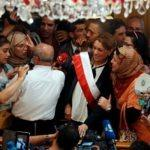 1138377-souad-abderrahim-candidate-of-the-islamist-ennahda-party-poses-for-pictures-with-supporters-after-be